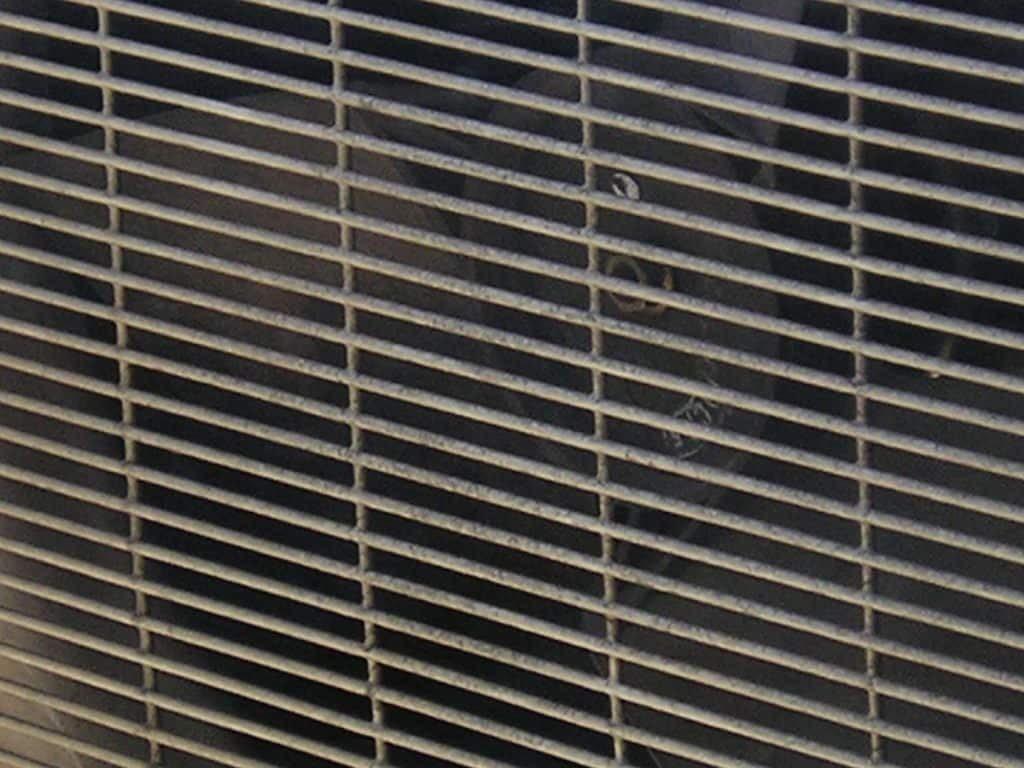 Image of dirty AC filter. Cleaning and replacing your AC filter will help prolong your AC's life and help keep your home's air clean.