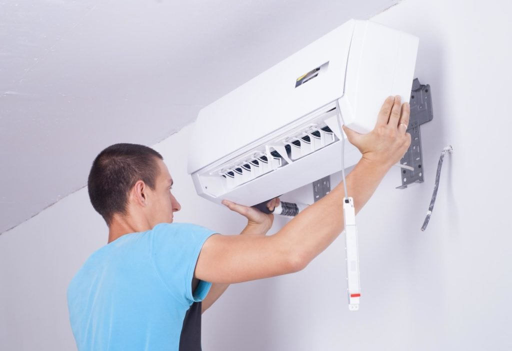 Image of man installing a mini split indoor unit